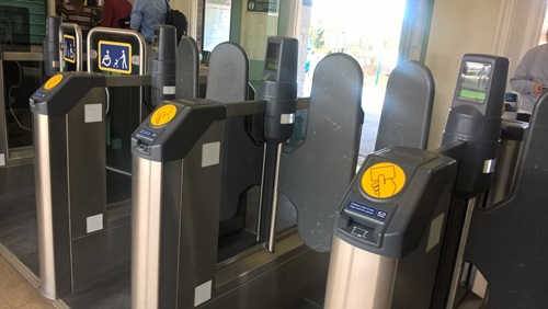 a row of parking meters in front of a store